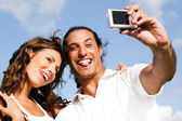Funny smiling couple caught in camera — Stock Photo