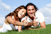 Man and lady showing thumbs up — Stock Photo