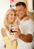 Couple sharing wine and smiling — Stok fotoğraf