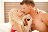 Lovers embracing in bed — Stock Photo