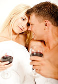 Mid adult couple enjoying wine — Stock Photo