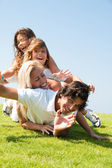 Portrait of happy family of four — Foto Stock