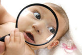 Baby's magnified face — Stock Photo