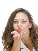Beautiful model blowing kiss to camera — Stock Photo