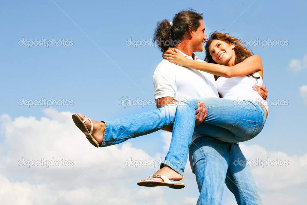 Young man holding woman in his arms stock photo 169 imagerymajestic
