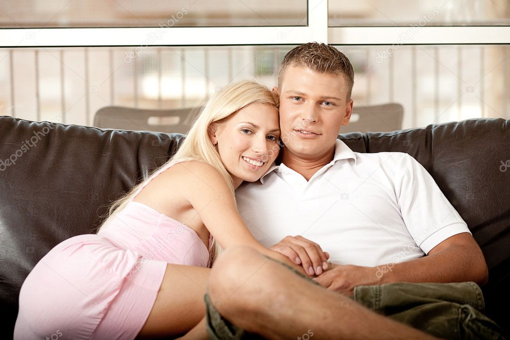 Young guy and lady embracing, while facing camera and relaxing — Stock Photo #1370787