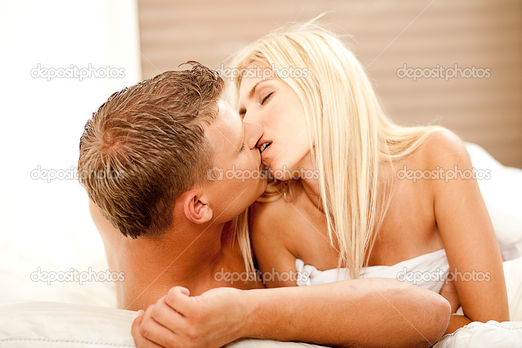 Intimate lovers in bed kissing each other  Stock Photo #1370920