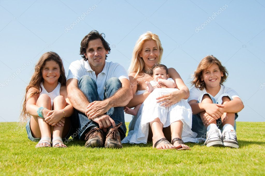Portrait of happy family of enjoying together on sunny day  Stock Photo #1371435