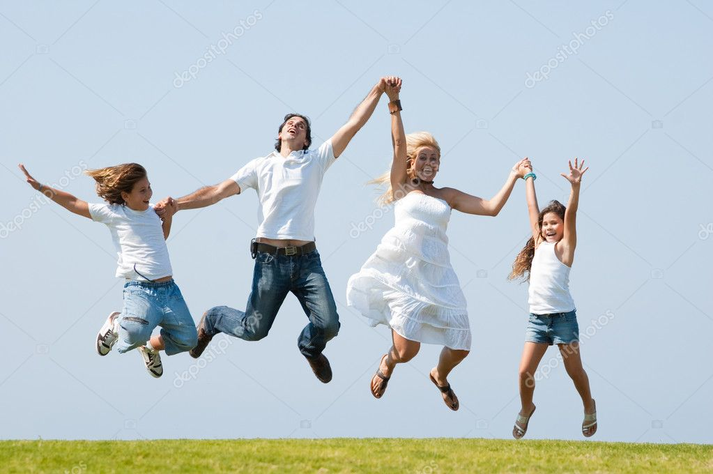 Happy family jumping high against natural background — Stock Photo #1371520