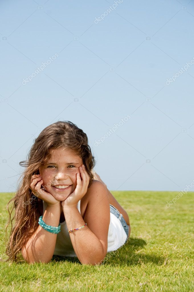 Young girl lying on ground and enjoying nature — Stock Photo #1371636