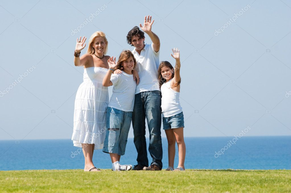 Portrait of happy family of enjoying together on sunny day — Stock Photo #1371676