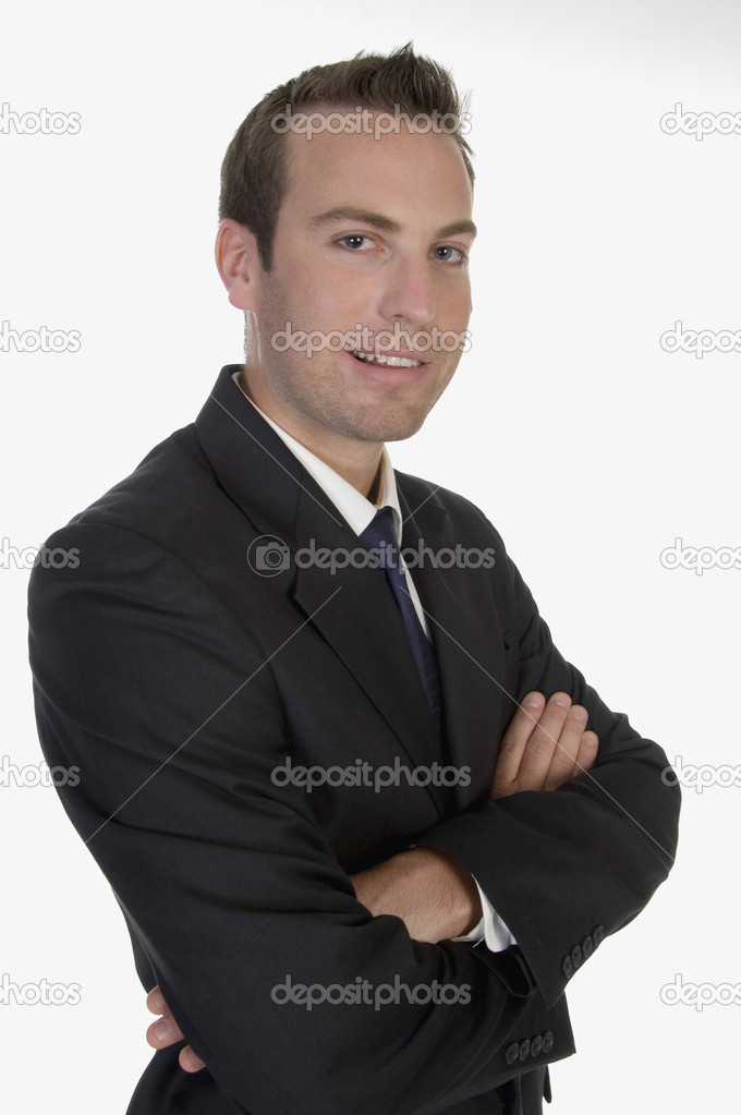 Young businessman posing on an isolated white background — Stock Photo #1372413