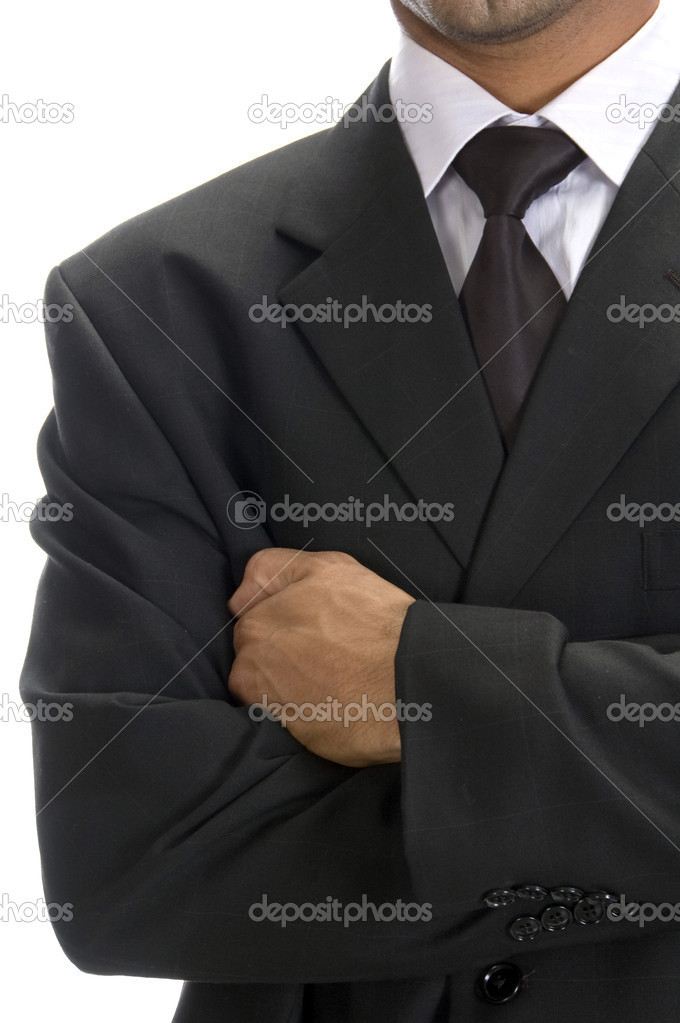 Front view of well dressed businessman with arms crossed — Stock Photo #1372603