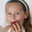 Young girl about to eat an apple — Stock Photo