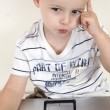 Little intellectual child with laptop — Stock Photo