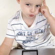 Stock Photo: Little intellectual child with laptop