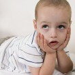 Young child in thinking pose — Stock Photo