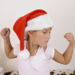 Little girl showing her muscles — Stock Photo