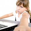 Little girl with laptop facing camera — Stock Photo #1649489