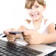 Smiling little girl with laptop posing — Stock Photo