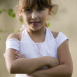Portrait of little girl with crossed arm — Stock Photo #1649524