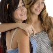 Teenager classmates hugging — Stock Photo