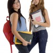 School girls posing with study material — Stock Photo