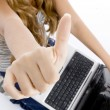 Girl with laptop showing her thumb — Photo