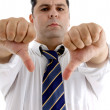 Businessman with thumbs down — Stock Photo