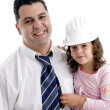 Little girl with hard hat and father — Stock Photo #1649997