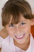 Little girl with milk mustache — Stock Photo