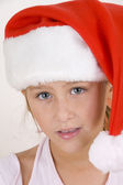 Smiling girl wearing christmas hat — Stock Photo