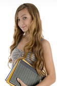 Teen girl posing with course books — Stock Photo