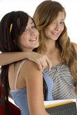 Teenager classmates hugging — Stock Photo