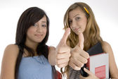 Young friends wishing goodluck — Stock Photo