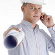 Royalty-Free Stock Photo: Busy male architect showing blueprints