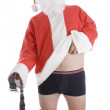 Santa clause holding his coat and belt - Stock Photo