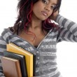 Gorgeous young student holding her books — Stock Photo