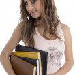 Young student with books smiling — Stock Photo