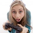 Surprised woman holding remote control — Stock Photo