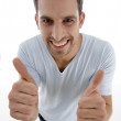 Young man showing thumbs up gesture — Stock Photo #1651626