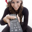 Smiling woman with remote control — Stock Photo #1651821