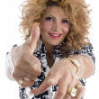 Smiling adult female pointing you — Stock Photo