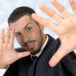 Stock Photo: Executive giving directing hand gesture