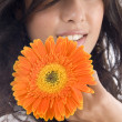 Close up of beautiful model with flower — Stock Photo #1652445