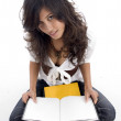 Female posing with her opened books — Stock Photo