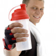 Healthy fit man posing with bottle — Stock Photo #1652526