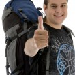 Young traveler gesturing thumbs up — Stock Photo #1652691