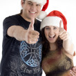 Happy young couple wearing christmas hat — Stock Photo #1652710