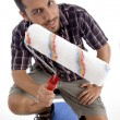 Close up view of man holding roller — Stock Photo